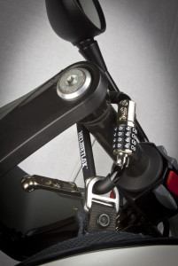 HelmetLok mounted on a dirt bike grip